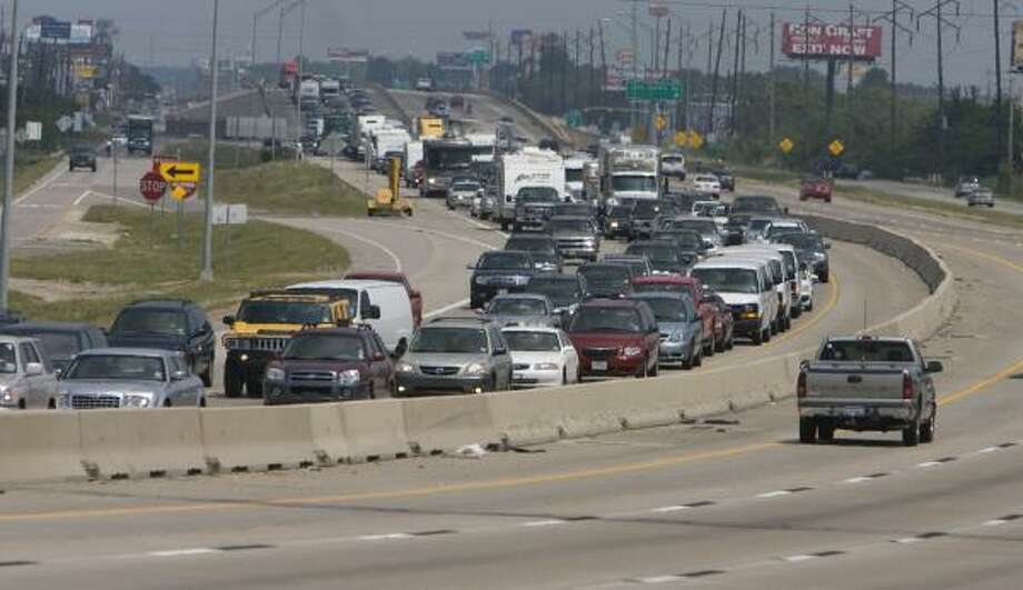 Westbound traffic on I-10 comes to a stop Saturday near Baytown. Heavy traffic also was reported on the Eastex Freeway late Saturday as Louisiana and Southeast Texas residents headed west through Houston. Photo: NICK De La TORRE, CHRONICLE