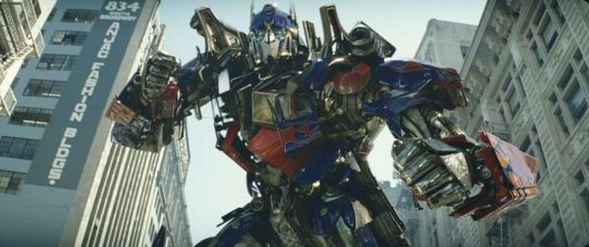 Optimus Prime, a member of an alien race, comes to help save the Earth in Transformers.