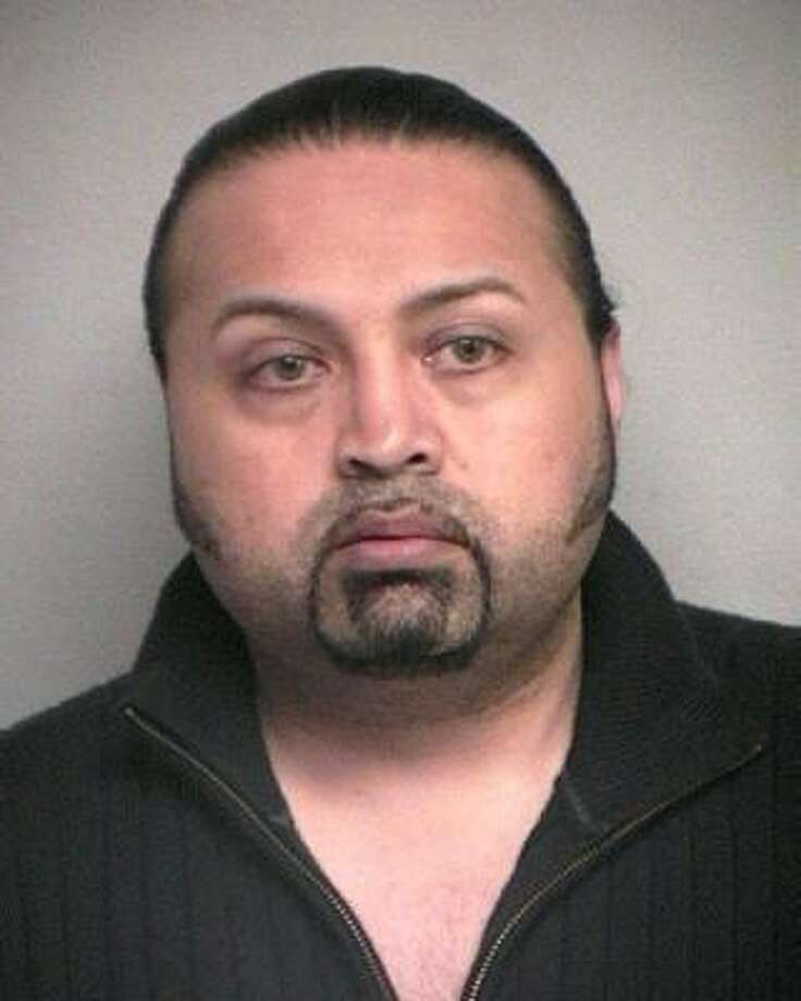 Salvador Solis, 40, is charged with robbery and impersonating an officer. Photo: Pasadena Police Department