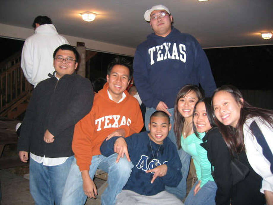 "Phanta ""Jack"" Phoummarath, center, poses for a photograph at the Dec. 9, 2005, fraternity initiation party before his death at the University of Texas. Photo: Family Photo"