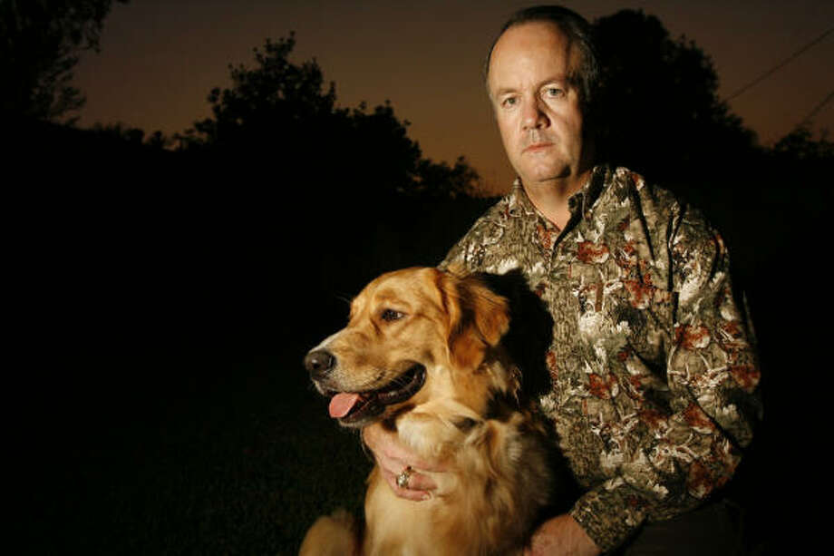 Hunter Mike Alford plans to take his year-old golden retriever, Tucker, for the dog's first hunt in December. Photo: James Nielsen, Chronicle