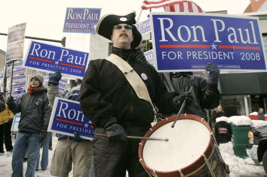 Eric Strathan, a supporter of Rep. Ron Paul, shows his allegiance in Manchester, N.H., on Friday. Photo: STEVEN SENNE, ASSOCIATED PRESS