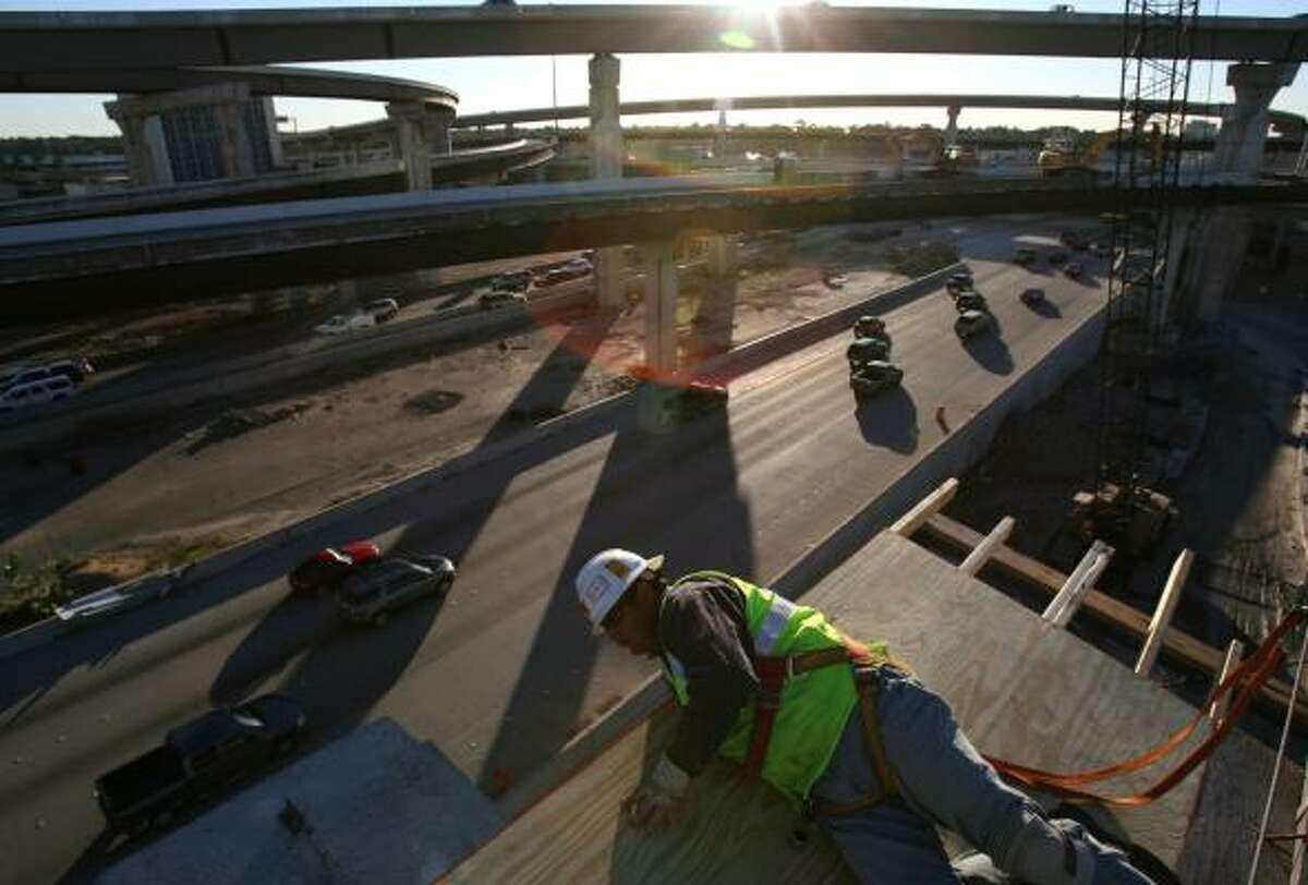 Jesus Ponce checks work on the Katy Freeway, which has cost about $1.7 billion and forced some streets and businesses to close. Commuters are eager for it to be finished.