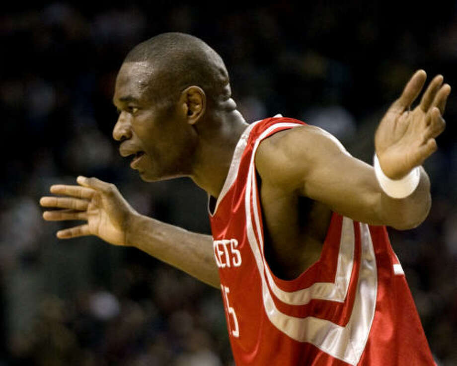Rockets center Dikembe Mutombo, who scored 11 points, reacts to a referee's call during the second half against the Blazers on Thursday. Photo: Don Ryan, AP