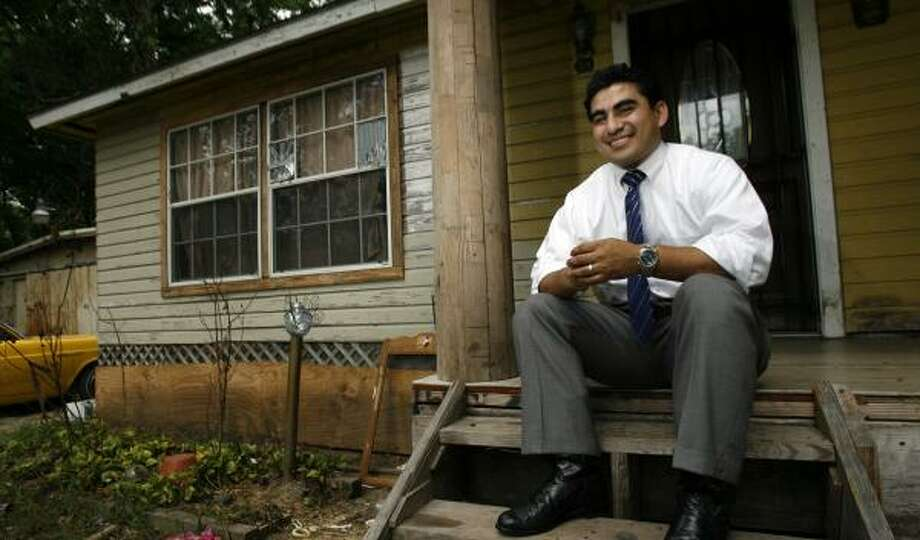 Armando Walle, 30, the incoming state representative for District 140, sits on the porch of the north Houston home in which he grew up. Photo: JOHNNY HANSON, CHRONICLE