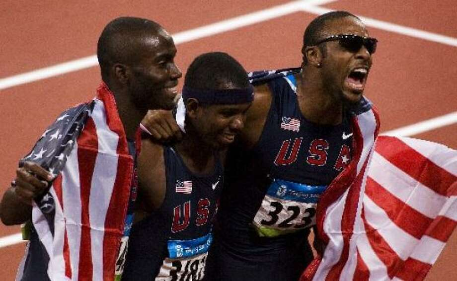 LaPorte's Kerron Clement (silver), left, Bershawn Jackson (bronze) and Angelo Taylor (gold) of the U.S. celebrate after sweeping the medals. Photo: Smiley N. Pool, Chronicle Olympic Bureau