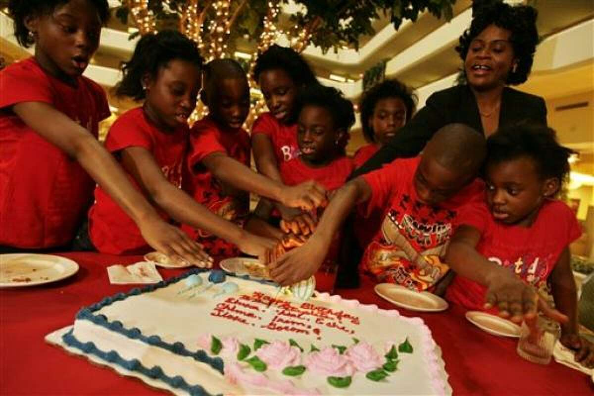 The surviving Chukwu octuplets celebrate their 10th birthday Saturday. From left, Ebuka, Echerem, Jioke, Chima, Gorom, Chidi and Ikem, cut the cake with their mom, Nkem Chukwu, right, and their youngest sister, Favor, 6.