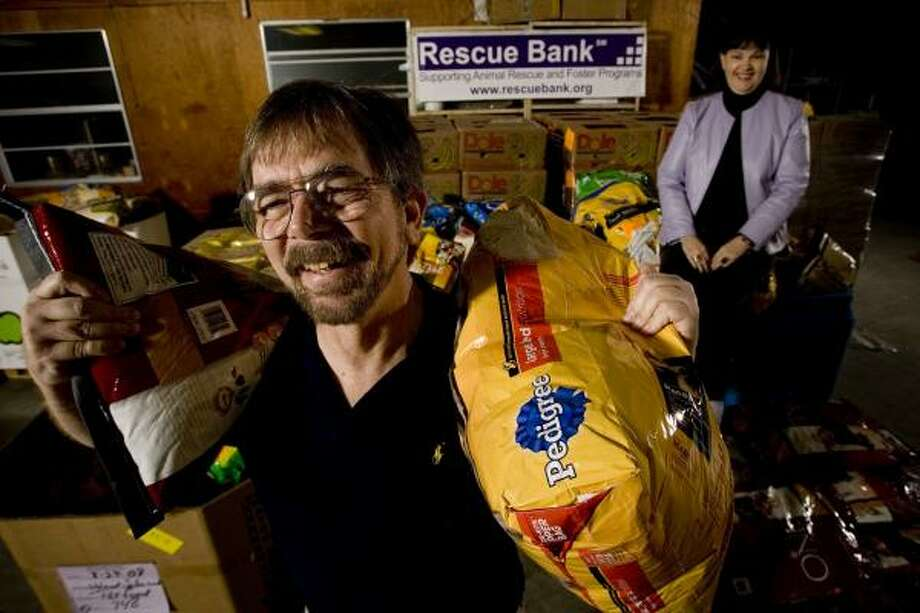 Two years ago, John Kane and Elizabeth Asher opened Rescue Bank, a nonprofit that supplies pet food to shelters much the same way the food bank fills pantries. Photo: ERIC KAYNE, CHRONICLE