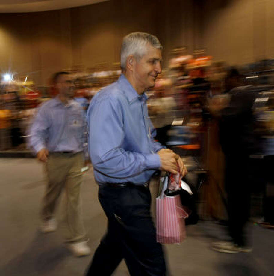 Jim McIngvale leaves a recent speech in Clear Lake. He told the crowd that night that he taught his employees to come back from adversity. Photo: Julio Cortez, Chronicle