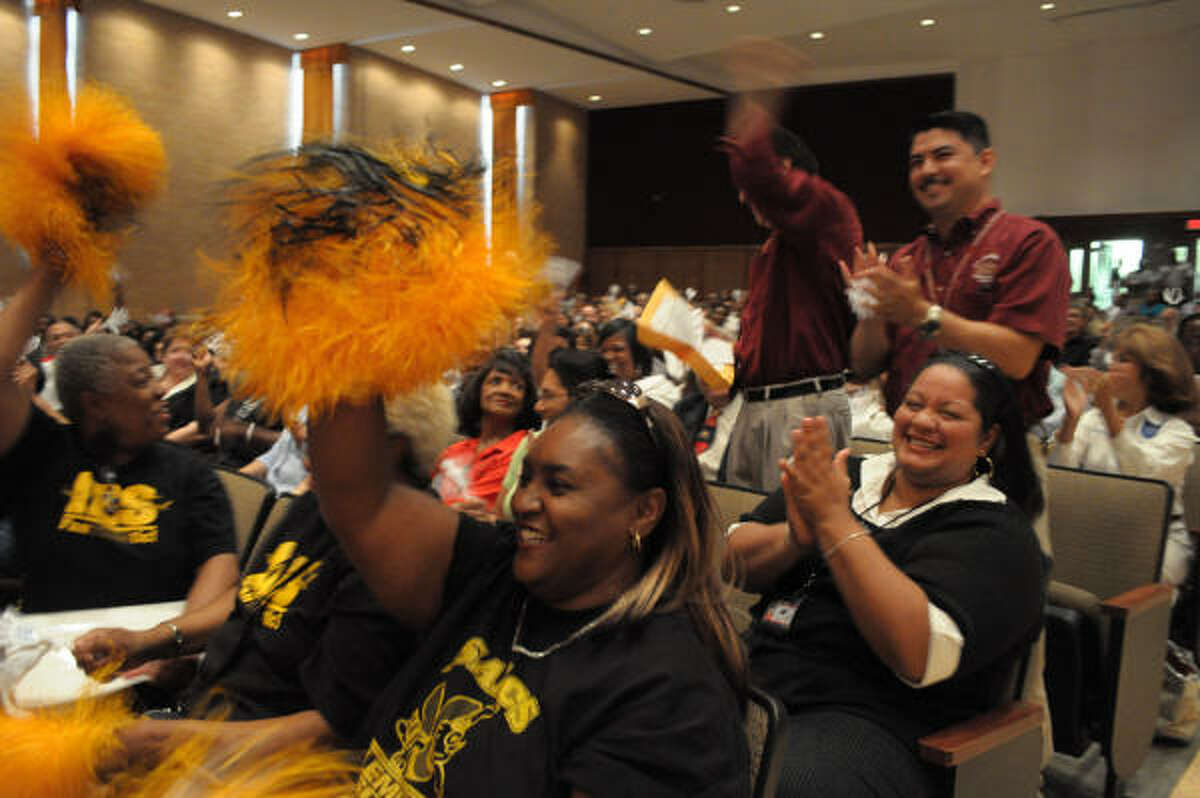Audience members at the Sam Houston Math, Science and Technology Center give a big round of applause on Friday for the improved ratings of Houston ISD schools.