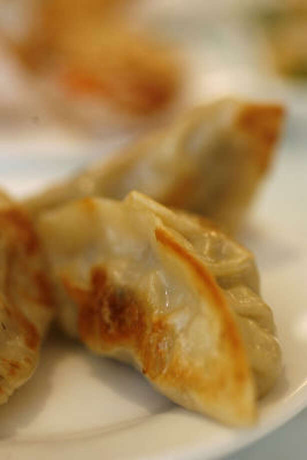 Dress up your favorite dumpling with simple and savory Soy-Ginger Dipping Sauce. Photo: Karen Warren, Houston Chronicle