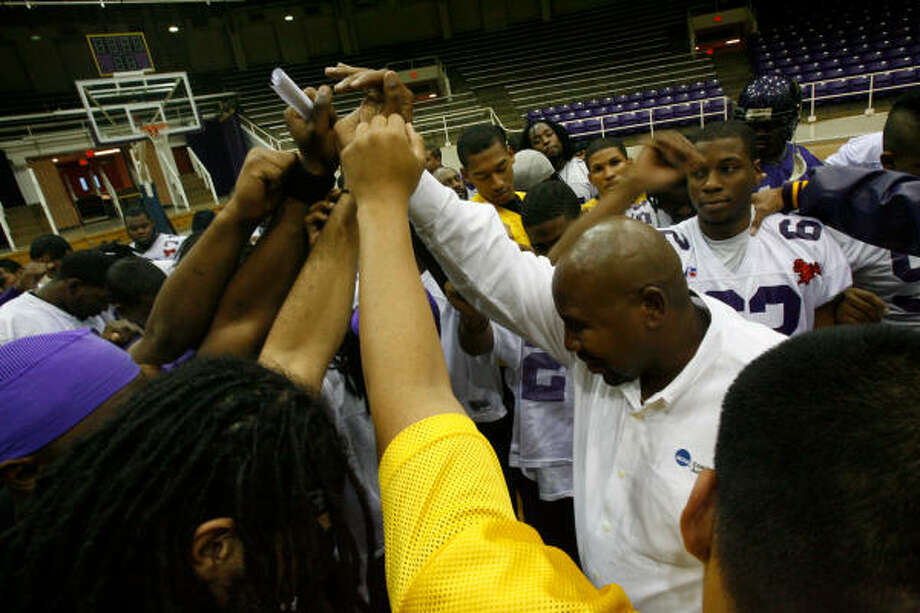 Prairie View A&M football coach Henry Frazier III, right, gathers his team before heading off to the SWAC title game in Birmingham, Ala. Photo: Julio Cortez, Chronicle
