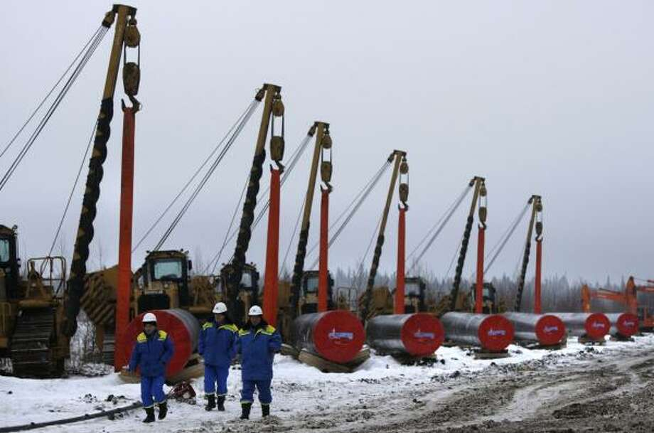 Poland gets half of its natural gas from Russia, where these cranes helped connect a new pipeline last year in the Yamal Peninsula. U.S. companies will drill in Poland, which seeks energy security after a recent Russian-Ukrainian conflict cut its supplies. Photo: Misha Japaridze, Associated Press