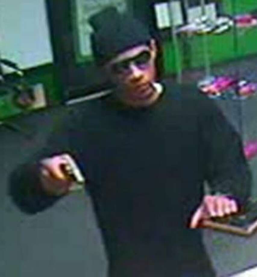 Police say this man robbed a southwest Houston cell phone store on Dec. 7. Photo: Surveillance Photo