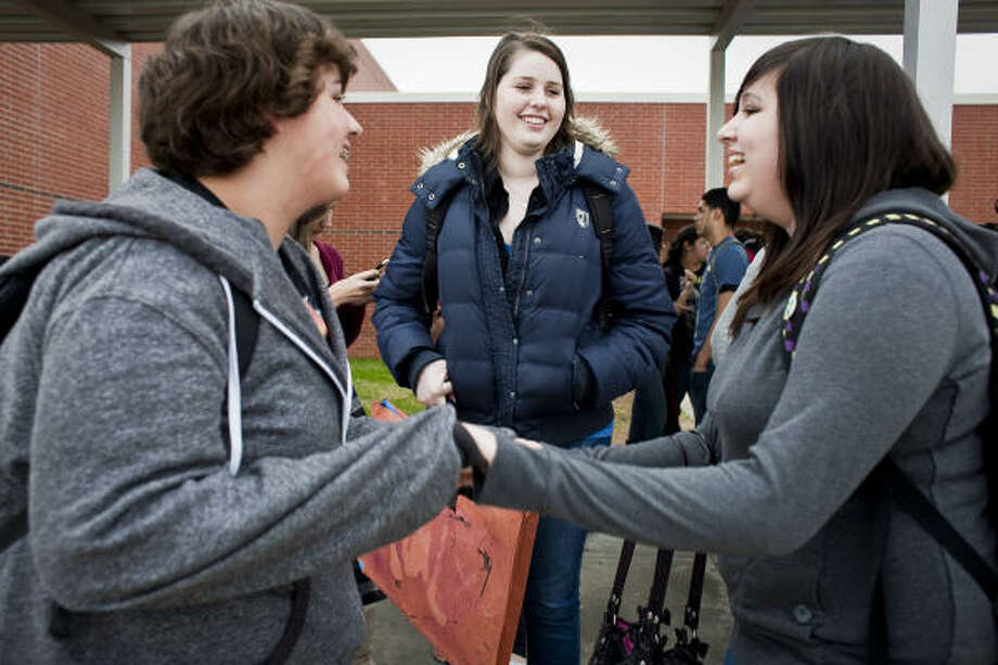 "Her mother says Carly Davis, center, ""goes to school and just enjoys every minute."" One reason is that friends like Stephen Selchert, left, and Destiny Juarez try to keep her smiling. Photo: Eric Kayne, Chronicle"