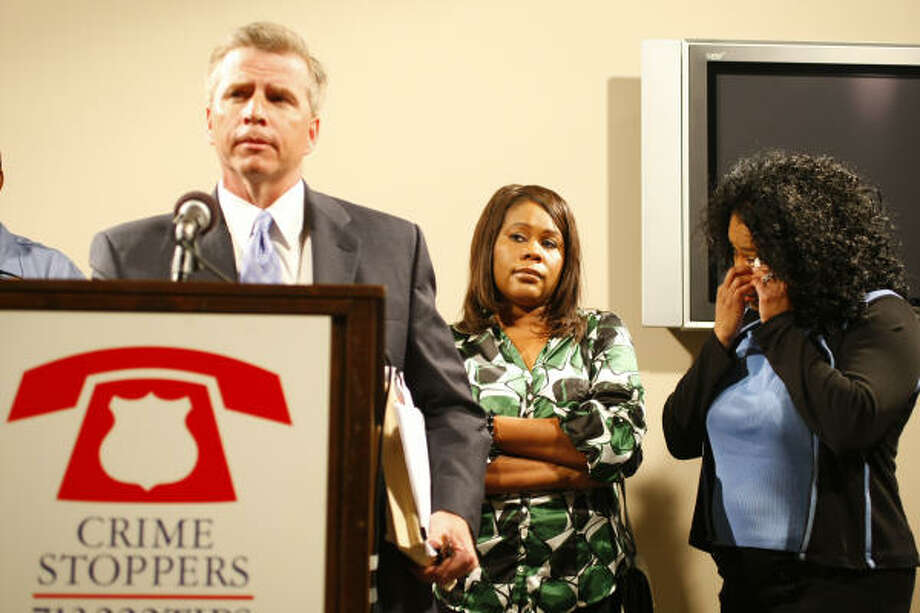Andrea Phillips, center and Debra Hale Knox listen as Houston Police Sgt. Brian Harris answers questions Monday about their sister Angela Faye Phillips, whose body was identified almost 24 years after she disappeared. Her killer has never been identified. Photo: Nick De La Torre, Chronicle