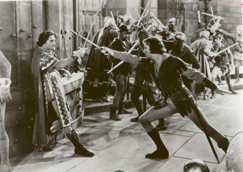 Basil Rathbone, left, and Errol Flynn in 1938. Photo: Warner Bros. Pictures