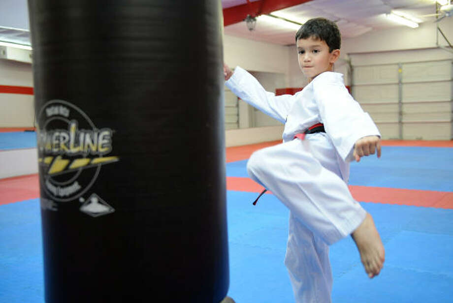 CONCENTRATION: Michael Rodriguez, 7, won a gold medal at the recent 6- and 7-year old advance division at the 2010 National American Amatuer Union Youth and Adult Championship  tae kwon do tournament held in Ft. Lauderdale, Fla. recently. Photo: Thomas Nguyen, For The Chronicle
