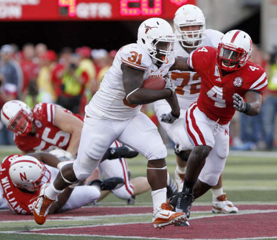 The most encouraging development for Texas on Saturday at Nebraska was the play of an offensive line that opened holes for the likes of Cody Johnson to rack up 209 yards rushing. Johnson led the way with 73 yards on 11 carries. Photo: Nati Harnik, AP