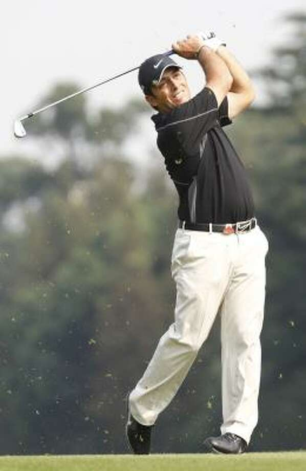 Francesco Molinari ohits the ball from the fairway at the 13th hole during the second round on Friday. Photo: AP