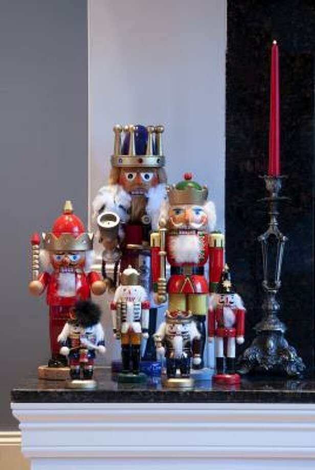 """Jeffrey Wade, whose Tulane Street home is on the Heights Holiday Home Tour, collects nutcrackers and often groups them by """"profession."""" We added a few soldiers to this small army of kings. Photo: Don Glentzer"""