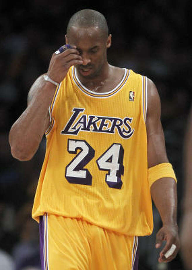 Lakers guard Kobe Bryant says he isn't panicking but he is feeling some pressure following consecutive losses at home. Photo: Chris Carlson, AP