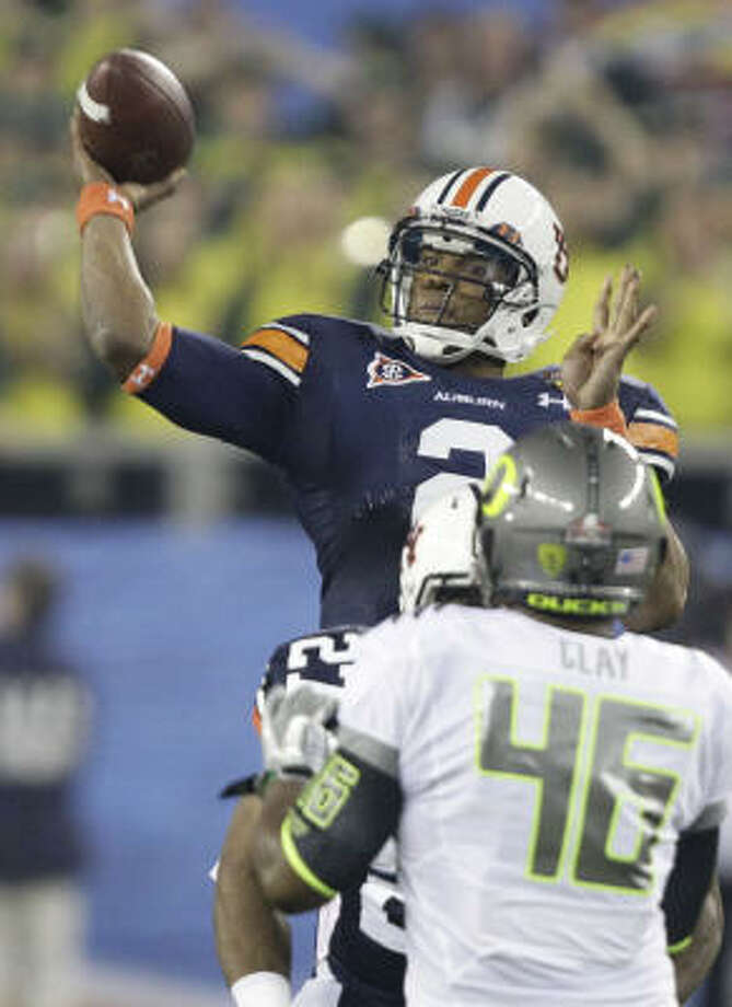 Auburn quarterback Cam Newton passed for 265 yards and two touchdowns in Monday night's victory. Photo: Matt York, AP