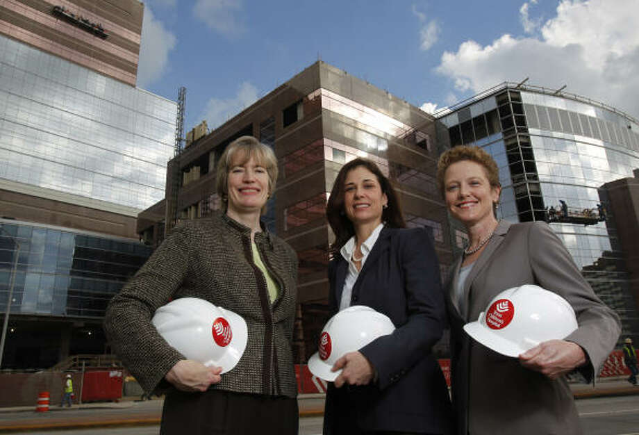 Diane Osan, from left, Cris Daskevich and Laura Bellows are the three women most involved with the design of the Texas Children's Hospital Pavilion for Women, which is under construction at the Texas Medical Center. Photo: Melissa Phillip, Houston Chronicle