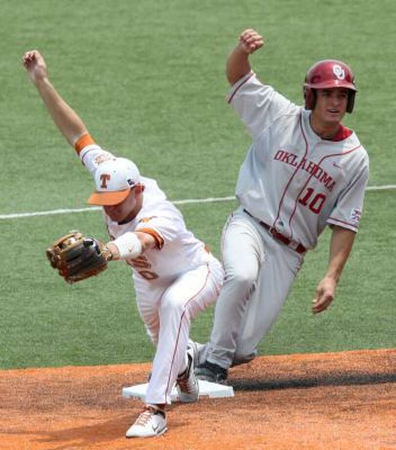 Texas' Brandon Loy, left, holds the ball as Oklahoma's Rick Eisenberg, right, arrives at second base on Sunday. Photo: Brenda O'Brian, Associated Press