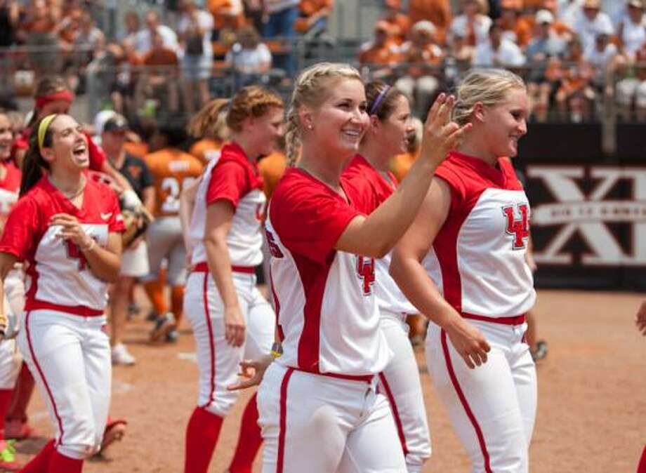 Donna Bourgeois, flanked by Holly Anderson (right), flashes the cougar paw as UH advances to the Austin Regional championship. Photo: UH Athletics