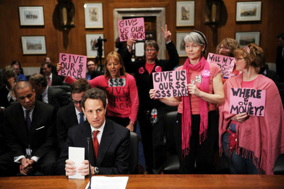 Members of  the peace and social justice group Code Pink make a statement Tuesday as Treasury Secretary Timothy Geithner prepares to speak before the Congressional Oversight Panel in Washington. Confidence in the bailout program is wearing thin on Capitol Hill. Photo: TIM SLOAN, AFP/Getty Images
