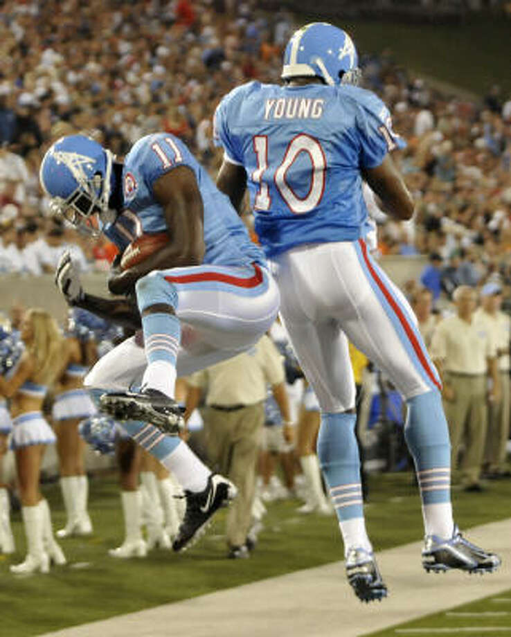 Tennessee Titans wide receiver Paul Williams, left, and quarterback Vince Young celebrate after Williams caught a touchdown pass in the second quarter. Photo: David Richard, AP