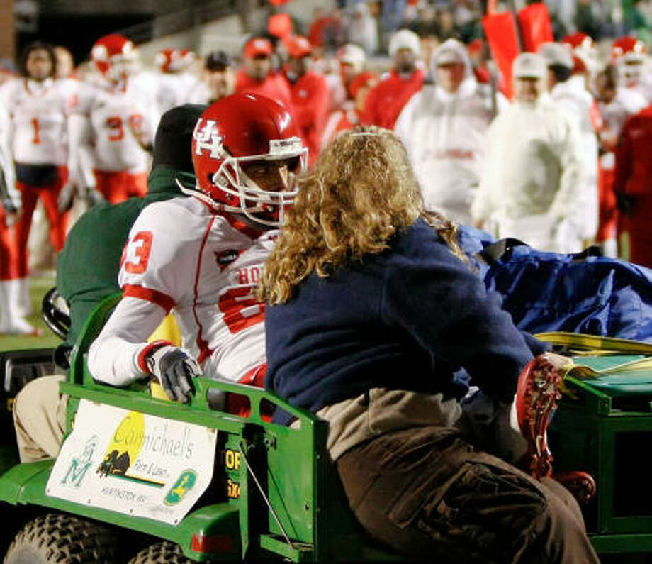 Patrick Edwards was carted off after colliding into a cart while chasing an overthrown pass. Photo: Jeremy McKnight, AP