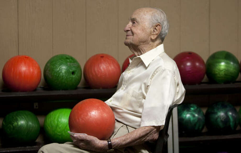 Harry Pepper, 100, has been bowling since 1939. Pepper, who bowls in a Friday morning league, says his best score is about 220 and he bowled over 200 last year. Photo: Nick  De La Torre, Houston Chronicle