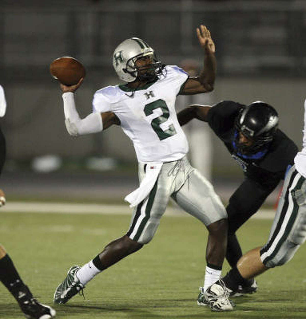 Hightower quarterback Bralon Addison throws the ball down field during the victory over Clear Springs on Friday night.