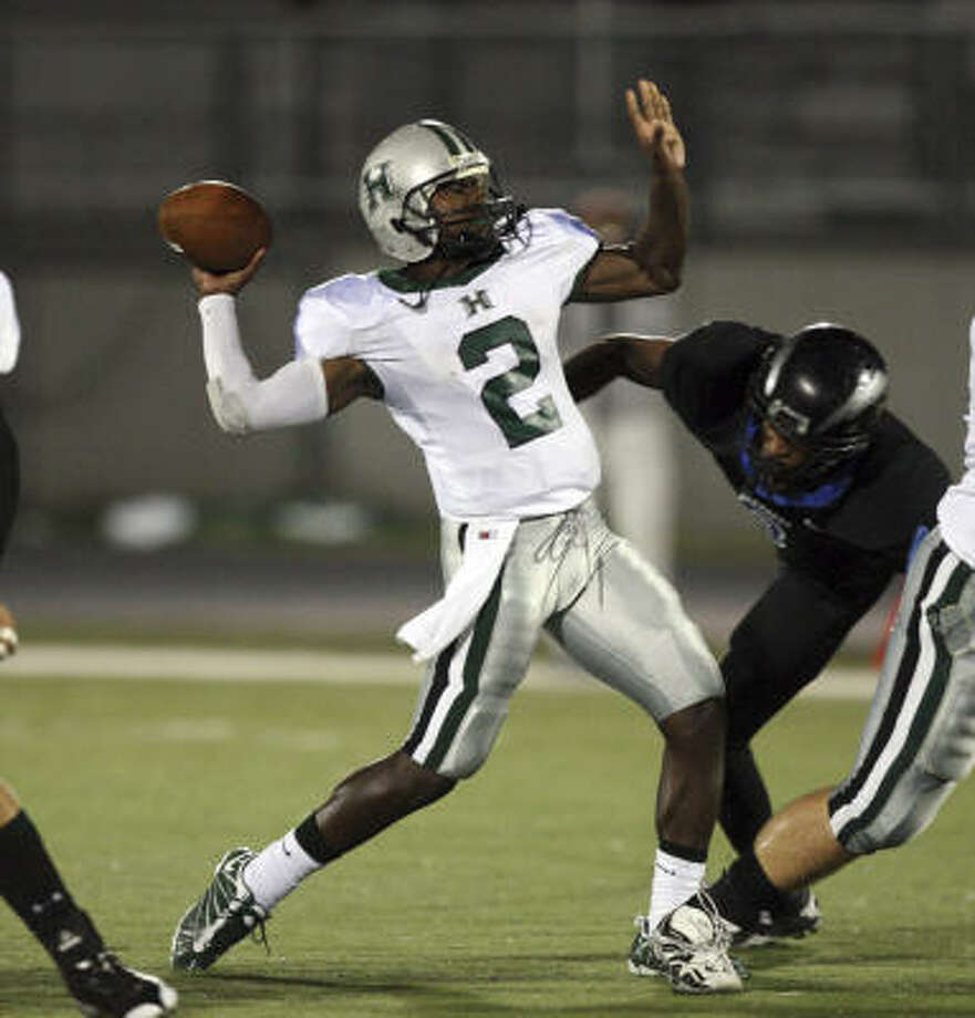 Hightower quarterback Bralon Addison throws the ball down field during the victory over Clear Springs on Friday night. Photo: Bob Levey, For The Chronicle