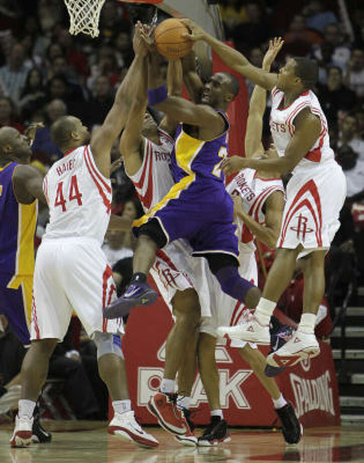 Rockets defenders stop a drive by Lakers guard Kobe Bryant. Photo: Karen Warren, Chronicle