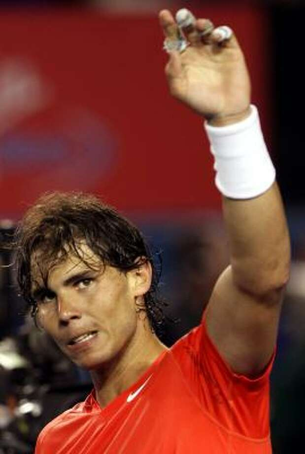 Rafael Nadal waves to the crowd after beating Bernard Tomic during the third round on Saturday. Photo: Rob Griffith, AP