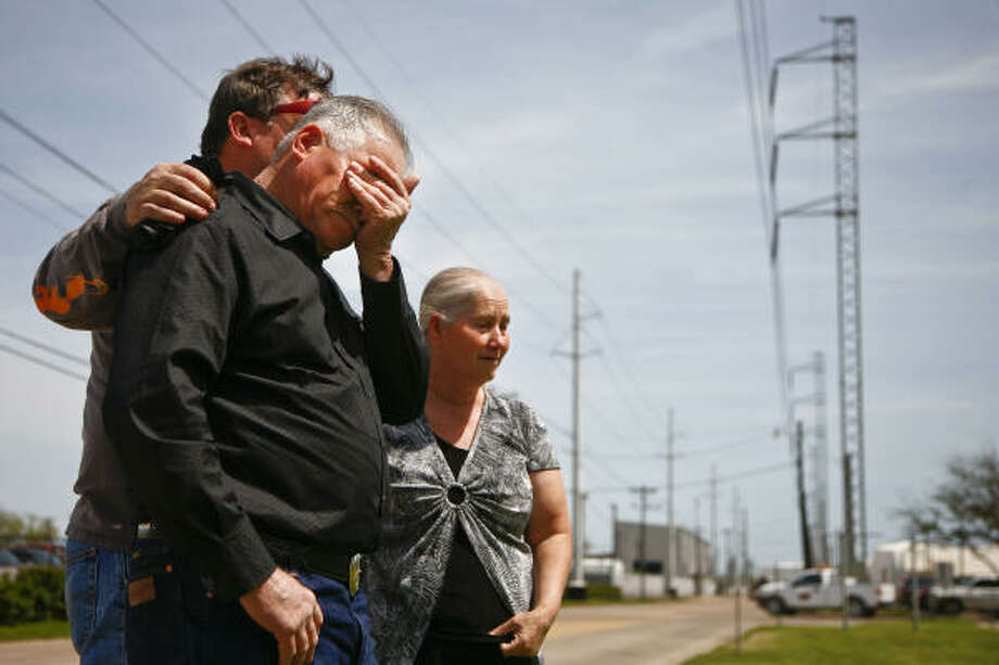 Paul Platz, who was working at the Texas City BP plant the day of the explosion five years ago, comforts Rafael Herrera on Tuesday at the BP Texas City site as Herrera and wife Magdalena reflect on the life of their son Rafael Jr., who died in the blast. Photo: Michael Paulsen :, Chronicle