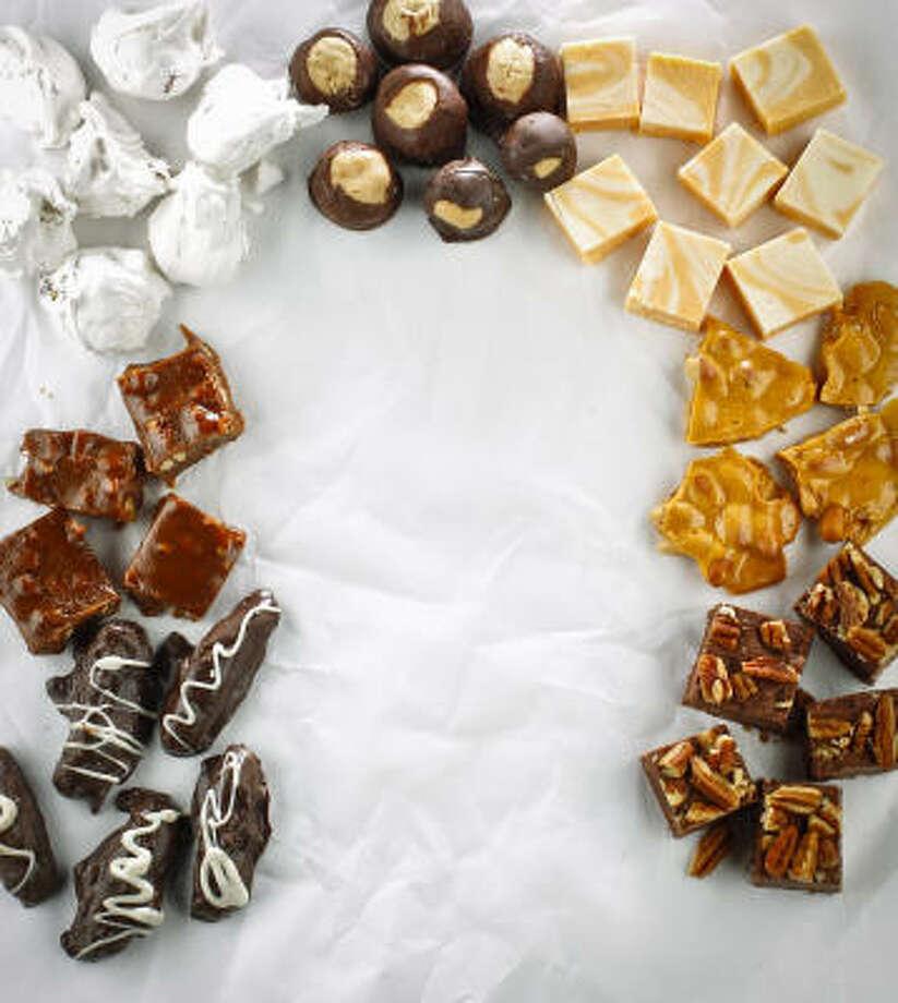 Clockwise from bottom left: Peanut Butter Logs, Mexican Orange Candy, Divinity, Texas Buckeyes, Orange Creamsicle Fudge, Crackin' Peanut Brittle, Fantasy Fudge Photo: Michael Paulsen, Chronicle
