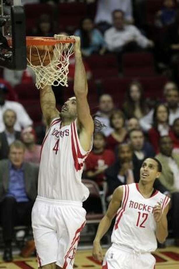 Rockets power forward Luis Scola throws down two of his game-high 23 points in Tuesday night's victory. Photo: Johnny Hanson, Chronicle