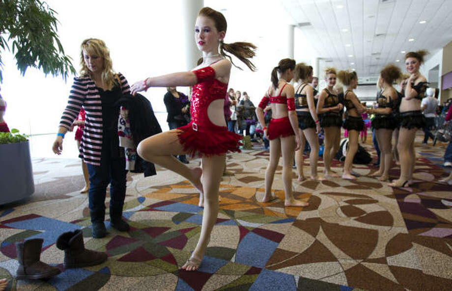 Camryn Dooley, 11, of the Starsteppers of Friendswood, practices a move before going into Sunday auditions for America's Got Talent. Photo: Brett Coomer, Chronicle