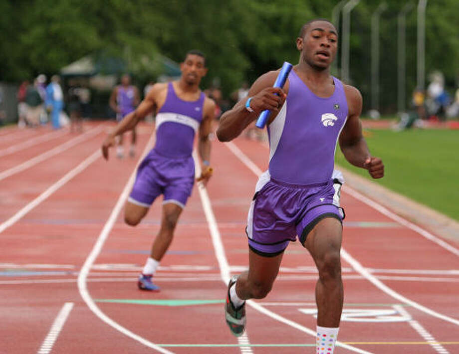 D.J. Monroe (front) says the relays are as important to him as the sprints. Photo: Gary Fountain, For The Chronicle