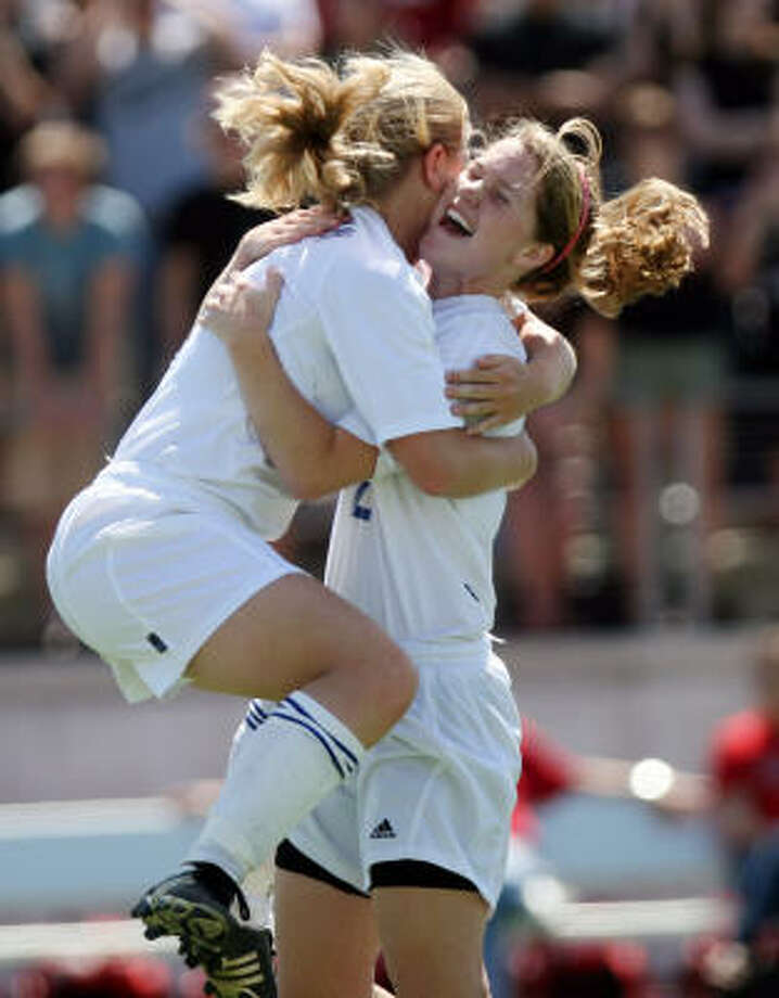Lauren Perryman, left, and Kristen Bowen celebrate Perryman's first half goal against Lake Travis. Photo: Chris Carson, For The Chronicle