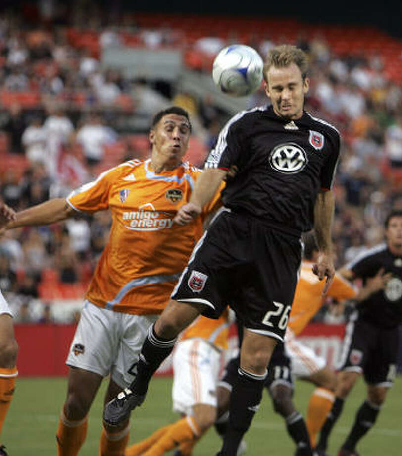 Geoff Cameron of the Dynamo chases D.C. United's Bryan Namoff in a SuperLiga game on July 19. Photo: Lawrence Jackson, AP