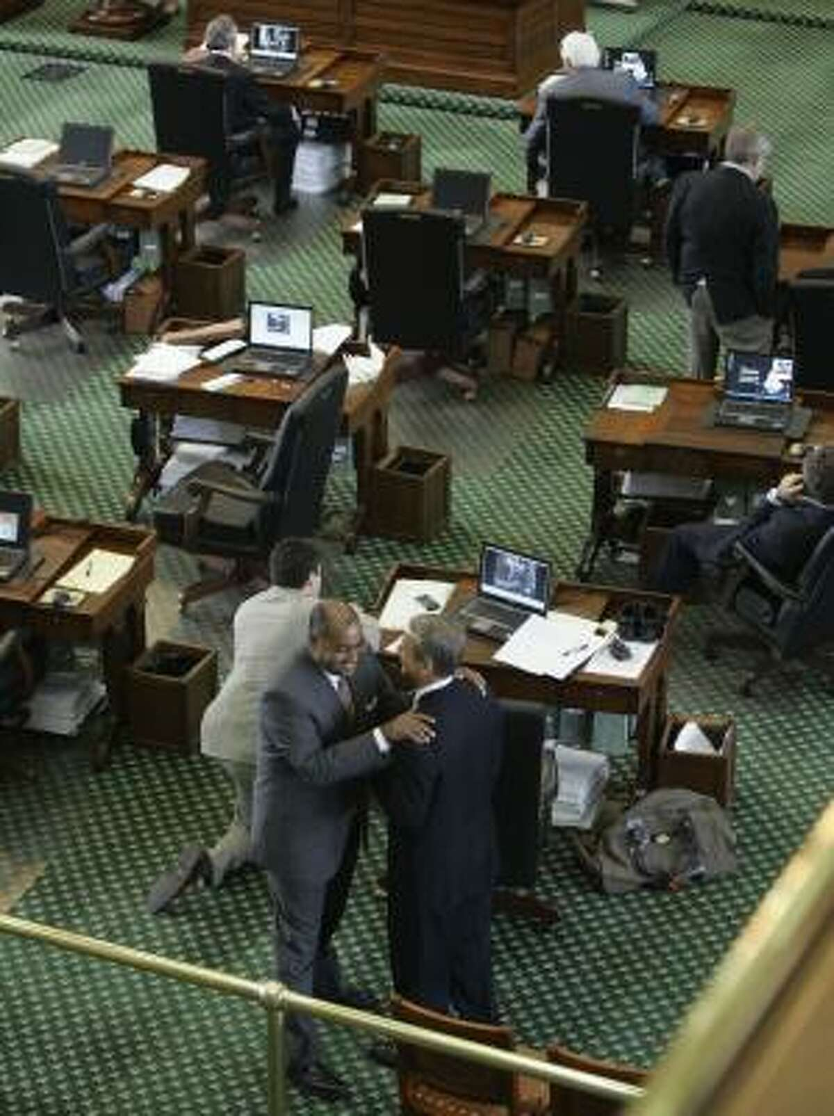 Sen. Rodney Ellis, D-Houston, standing on the left, talks with Sen. Kyle Janek, R-Houston, the day before the 80th Texas legislative session ended. During the final hours, Ellis represented the threat of a filibuster, which could have resulted in a special session to pass a budget. That did not happen, however.