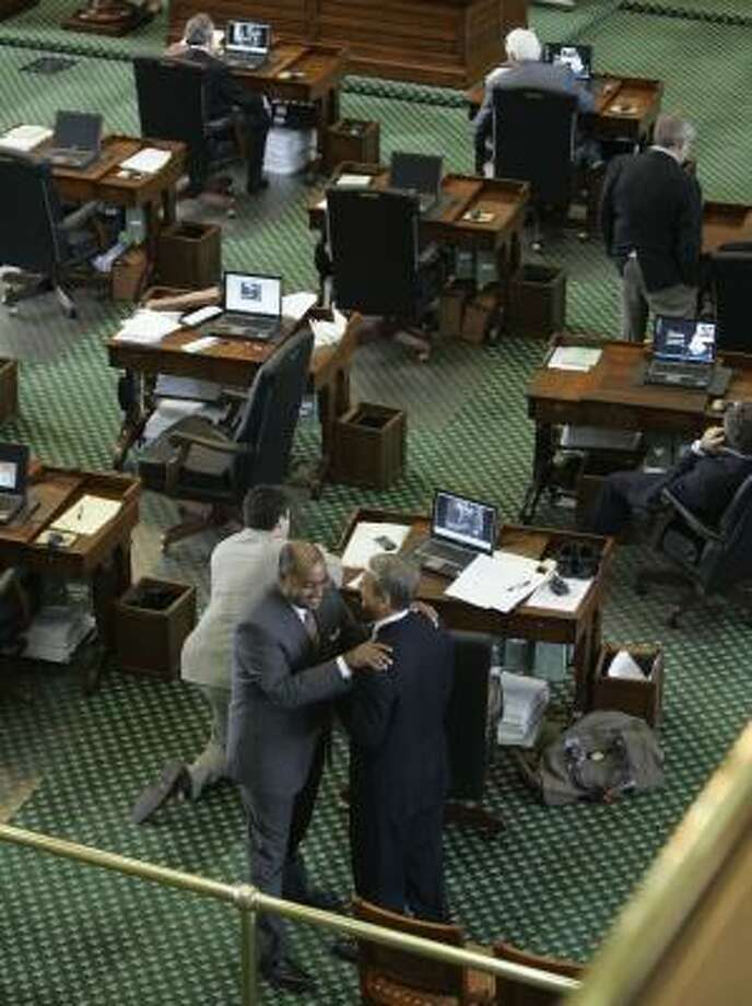 Sen. Rodney Ellis, D-Houston, standing on the left, talks with Sen. Kyle Janek, R-Houston, the day before the 80th Texas legislative session ended. During the final hours, Ellis represented the threat of a filibuster, which could have resulted in a special session to pass a budget. That did not happen, however. Photo: Harry Cabluck, AP