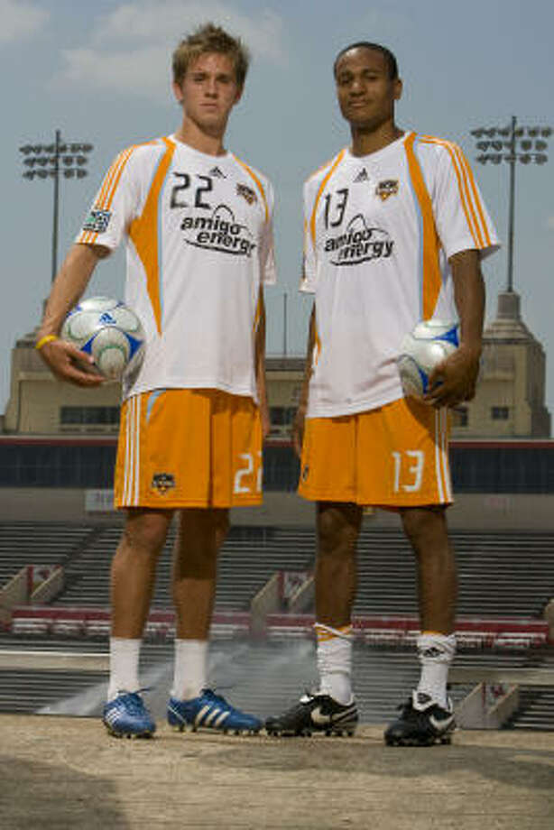 As the Dynamo aim to reclaim their place atop MLS, contributions by Stuart Holden, left, and Ricardo Clark in midfield will be key to the goal. Photo: James Nielsen, Chronicle