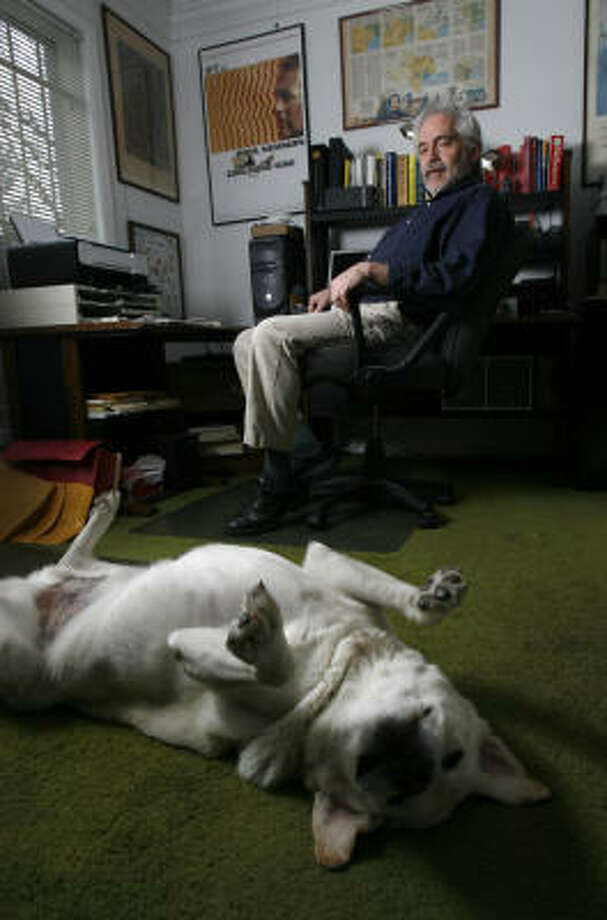 Gary Taylor, a Houstonian who self-published his book, Luggage by Kroger: A True-Crime Memoir, hangs out with his dog, Shane, at his home, where much of his book was written. Photo: Karen Warren, Chronicle