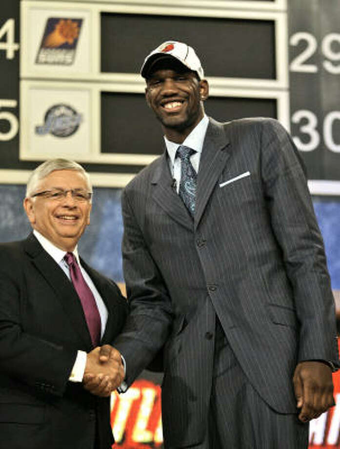 Ohio State's Greg Oden, right, is heading to the Portland Trail Blazers after being the first pick in the NBA draft. Photo: Kathy Willens, AP